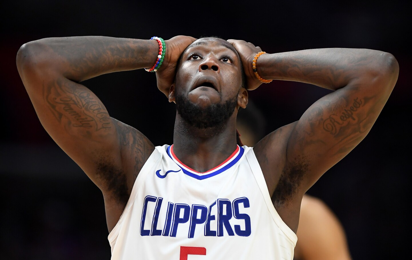 Clippers forward Montrezl Harrell walks down court after being called for a foul against the TImberwolves late in the fourth quarter.