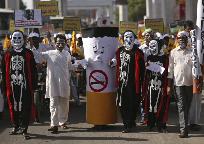 Indians dressed as skeletons and cigarette in a rally to mark World No Tobacco Day in in Hyderabad, India, Tuesday, May 31, 2016. The member states of the World Health Organization observe May 31 every year as World No Tobacco Day to draw global attention to the tobacco epidemic and to the preventa