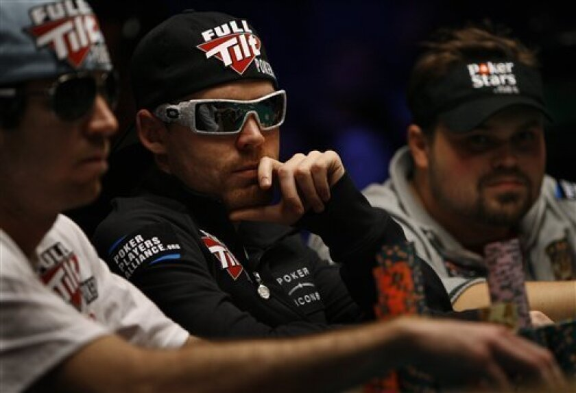 John Racener, left, Matthew Jarvis, and Jason Senti play a hand during the World Series of Poker in Las Vegas on Saturday, July 17, 2010. Today's play will determine the final table of the tournament. (AP Photo/Laura Rauch)