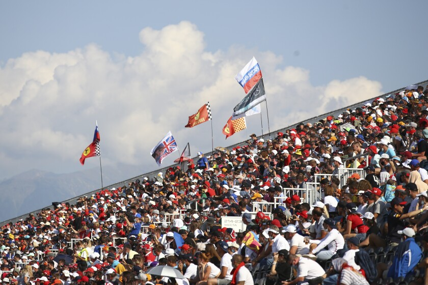 Spectators are on the stands during the Russian Formula One Grand Prix, at the Sochi Autodrom circuit, in Sochi, Russia, Sunday, Sept. 27, 2020. (Bryn Lennon, Pool via AP)