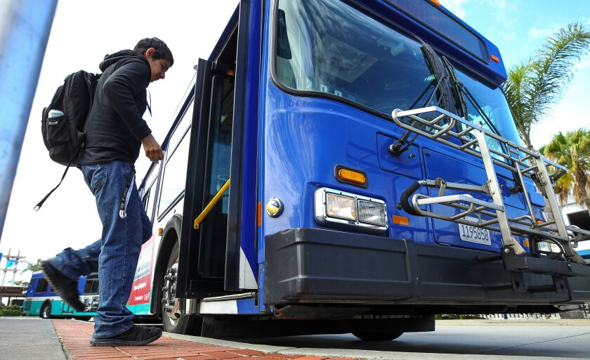 A man gets on a North County Transit District Breeze bus at the Oceanside Transit Center.