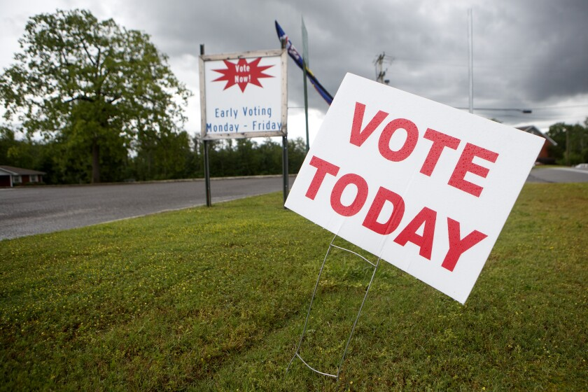 In this May 20, 2020, file photo, signage is seen near the road at the West Side Voting Precinct in Rossville, Ga. (C.B. Schmelter /Chattanooga Times Free Press via AP)