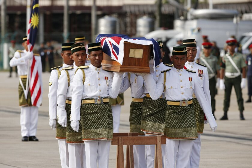 Australian military personnel carry a coffin during a repatriation ceremony for Australian soldiers at Subang military air base in Kuala Lumpur, Malaysia, Tuesday, May 31, 2016. The Australian soldiers, many who were casualties during the Vietnam War, were buried in Malaysia along with some depende