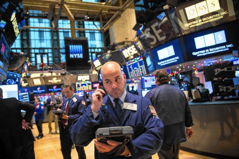 Traders work on the floor of the New York Stock Exchange on the first trading day of 2015.