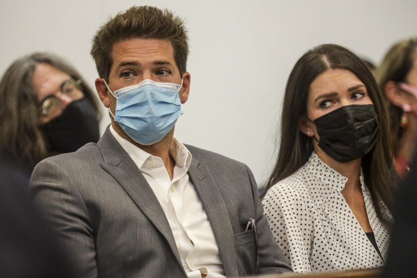 Accused doctor and his girlfriend masked up in court