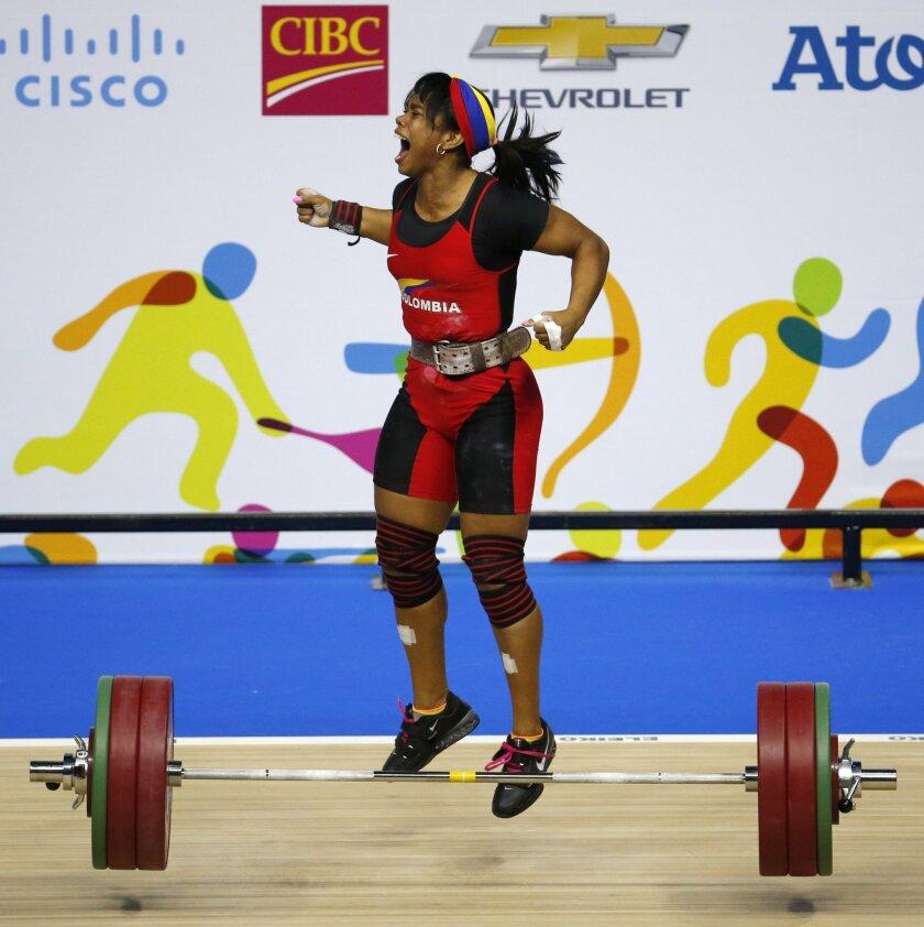 La pesista colombiana, Leidy Solís, reacciona tras conseguir la medalla de oro.