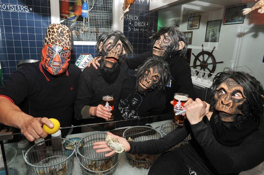 The Creepy Creeps enjoying brews and causing a riot behind the oyster bar at Beerfish. (Rick Nocon)