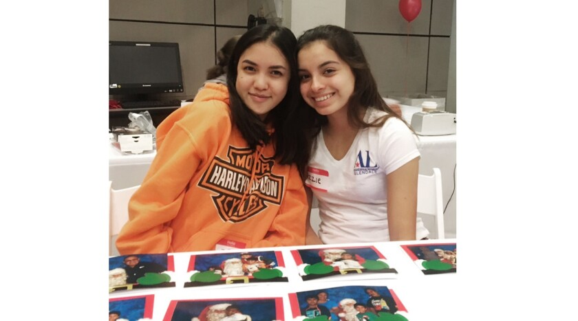 Glendale Assisteens Zoe Cerrillo, left, and Isabella Vinci volunteered at the Pajama Party for cance