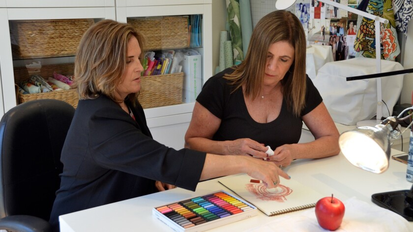 Art instructor, Sonserae Leese, left teaches Millie Palmer about chalk shading during a private tuto