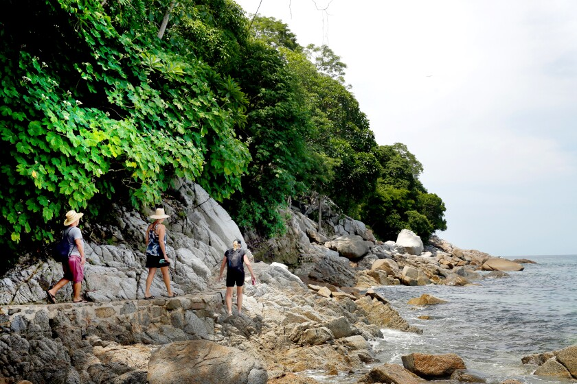A trail that hugs the shore takes hikers from Boca de Tomatlán to Quimixto in Puerto Vallarta, Mexico.