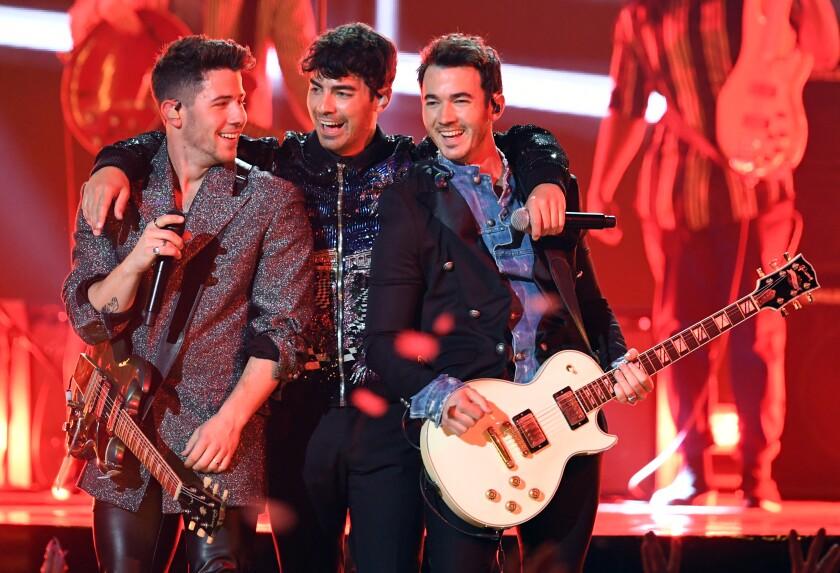 A photo of Nick Jonas, Joe Jonas, and Kevin Jonas of Jonas Brothers perform onstage during the 2019 Billboard Music Awards at MGM Grand Garden Arena on May 01, 2019 in Las Vegas, Nevada.