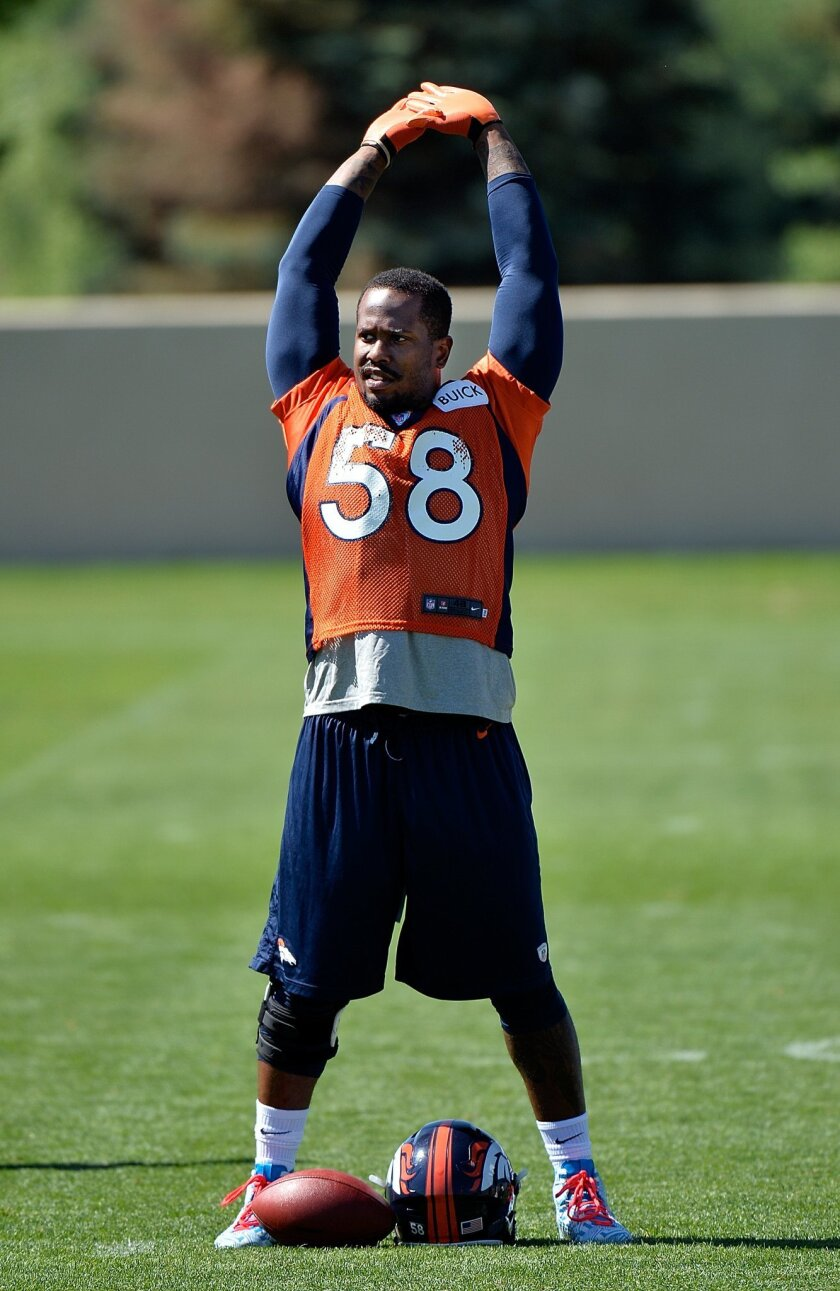 Denver Broncos' Von Miller stretches during an NFL football organized team activity, Monday, June 2, 2014, in Englewood, Colo. (AP Photo/Jack Dempsey)