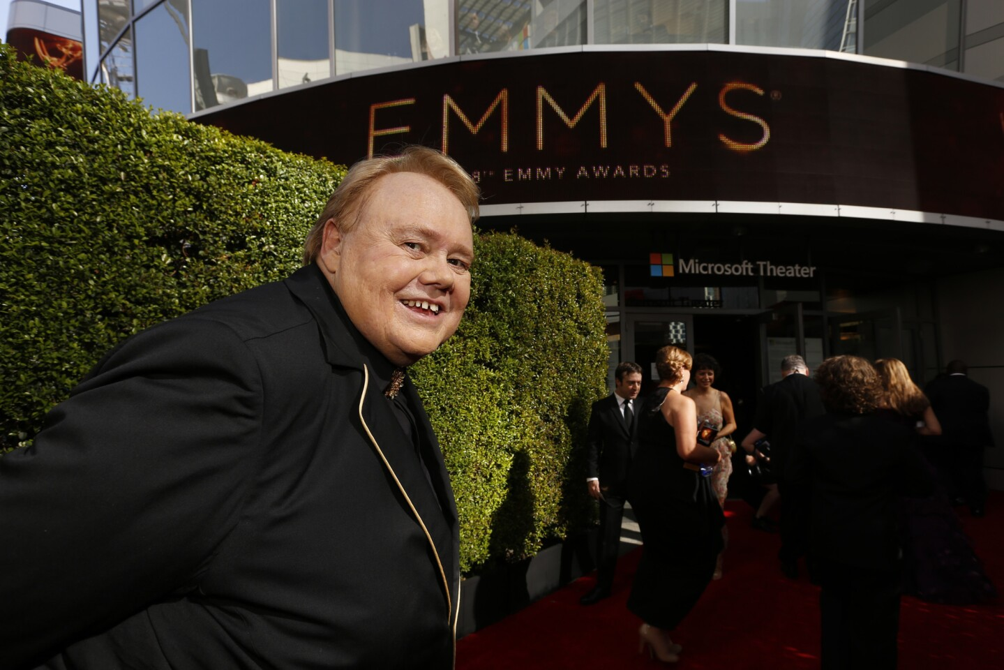 Louie Anderson gets ready to enter the Microsoft Theater.