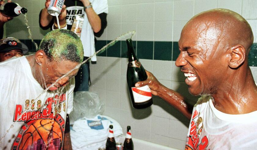 Michael Jordan and Dennis Rodman celebrate after the Bulls defeated the Jazz in the 1998 NBA Finals.