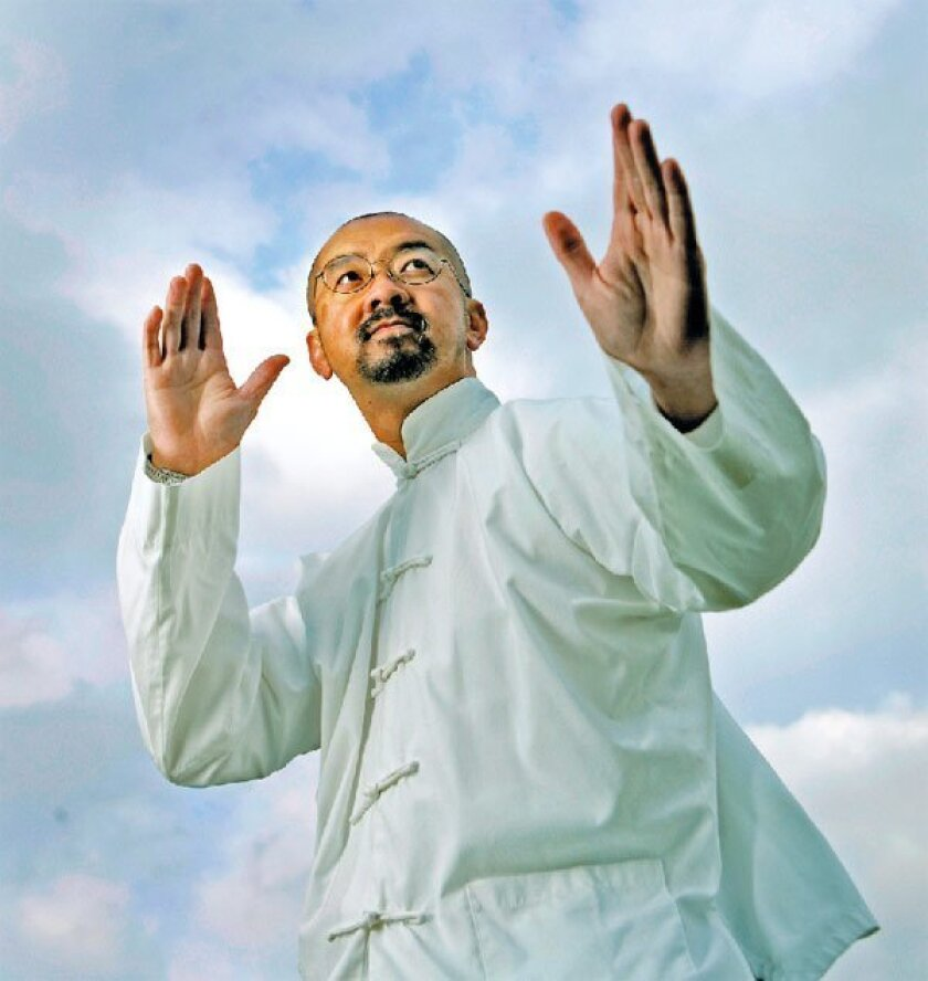 Henry Cheng, a fifth-generation master of tai chi, demonstrates 