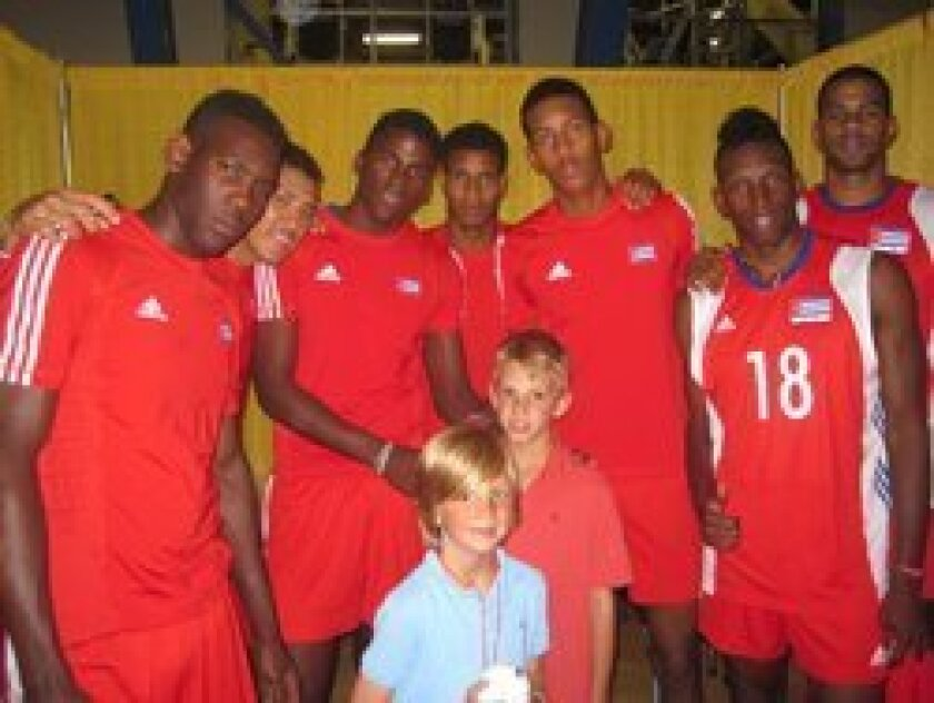 Blake Rovsek (in red shirt, second row) with the Cuban Olympic volleyball team.