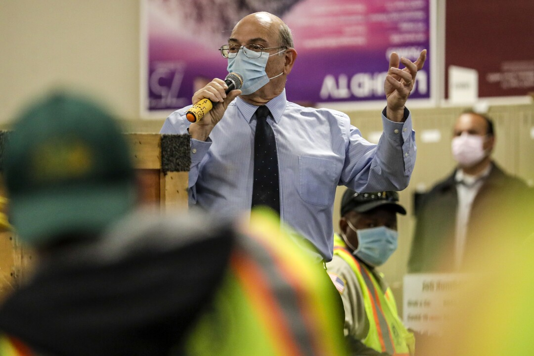 Marc Monforte, director of material management and purchasing, speaks to truck drivers assembled early morning at LAUSD Procurement Services Center in Pico Rivera