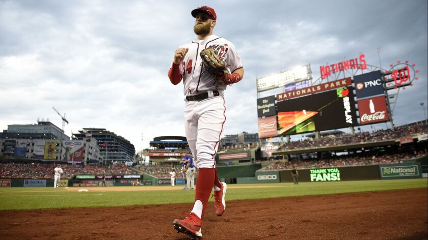 Washington Nationals right fielder Bryce Harper comes in from the outfield to the dugout during the