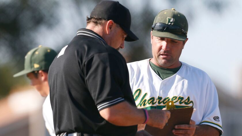Edison coach Cameron Chinn makes a pitching change in the seventh inning of a CIF-SS Div. 1 baseball