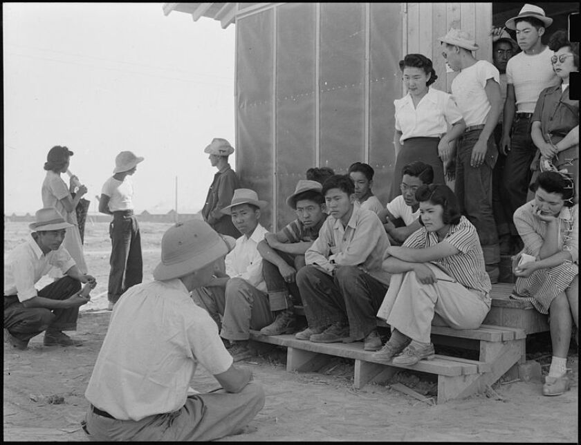 Poston internment camp detainees gather for some unknown instructional training.