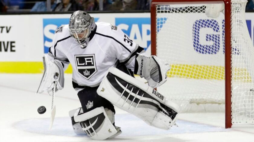 Kings goalie Jonathan Quick stops a shot during a game against the San Jose Sharks on Oct. 12.