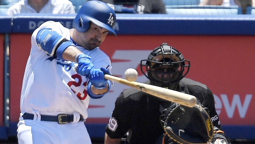 Adrian Gonzalez hits two RBI double against the Miami Marlins during the first inning on May 21.