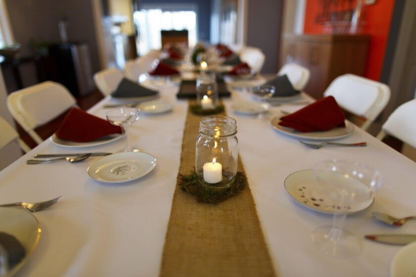 Don't hesitate to mix and match tables and chairs for a large dinner party.