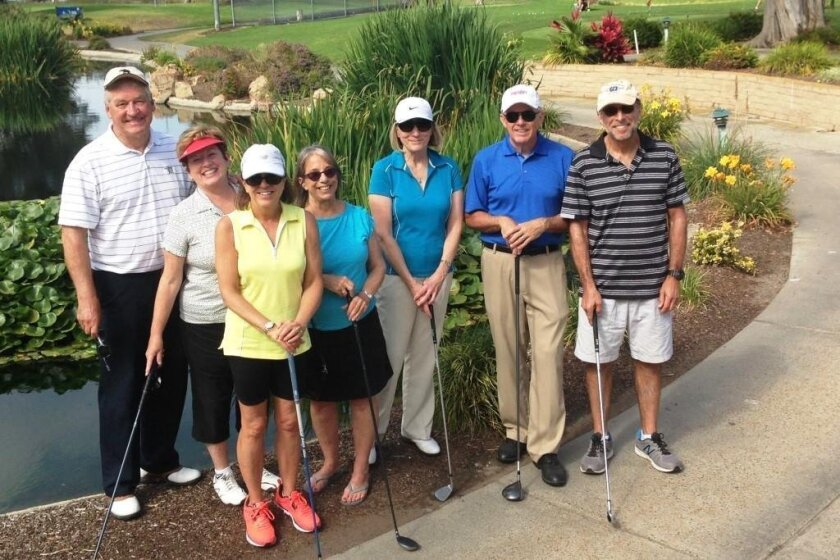 Alan and Terry McAnally, Linda Karelis, Marguerite Bartels, Jan and Tim Morris and Gary Karelis at a 'Pitch, Putt and Pint' activity June 8 at the Mission Bay Golf Club