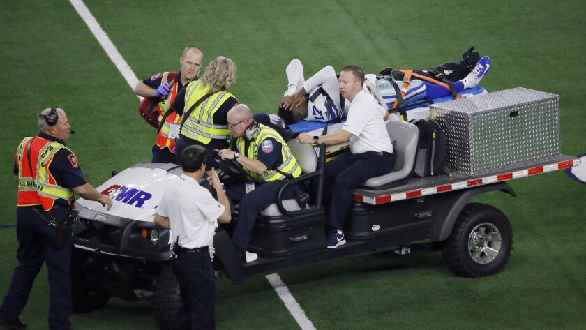 Dallas Cowboys wide receiver Allen Hurns (17) is taken from the field after injury against the Seatt