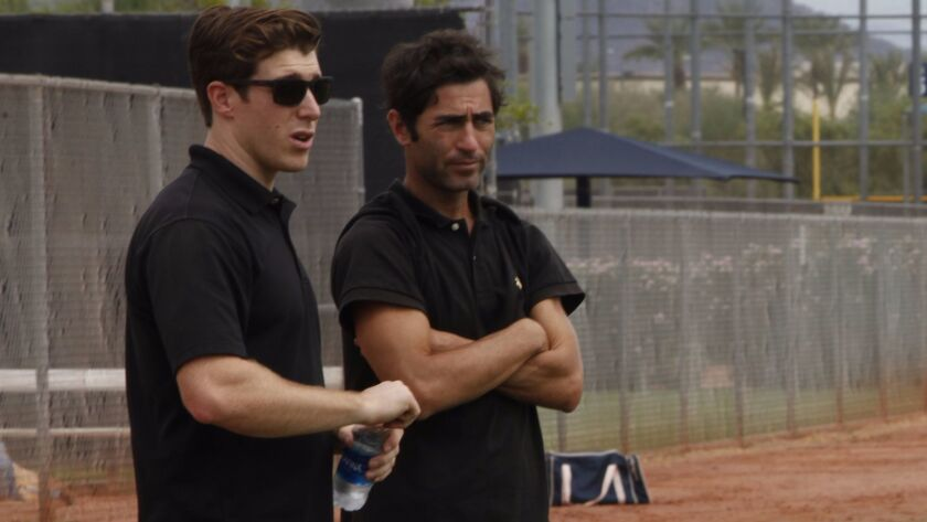 Padres General Manager A.J. Preller watches the action at the Padres instructional league on Tuesday with Ben Sestanovich, assistant director of player development.