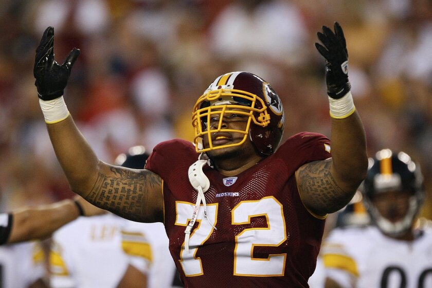 FILE - In this Aug. 12, 2011, file photo, Washington Redskins defensive end Stephen Bowen celebrates a play during the first half of an NFL preseason football game against the Pittsburgh Steelers in Landover, Md. Bowen has retired after playing 10 NFL seasons with Dallas, Washington and New York Je