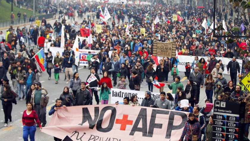 Some success: Chilean workers took to the Santiago streets on July 24 to demand reform of the country's privatized pension system.