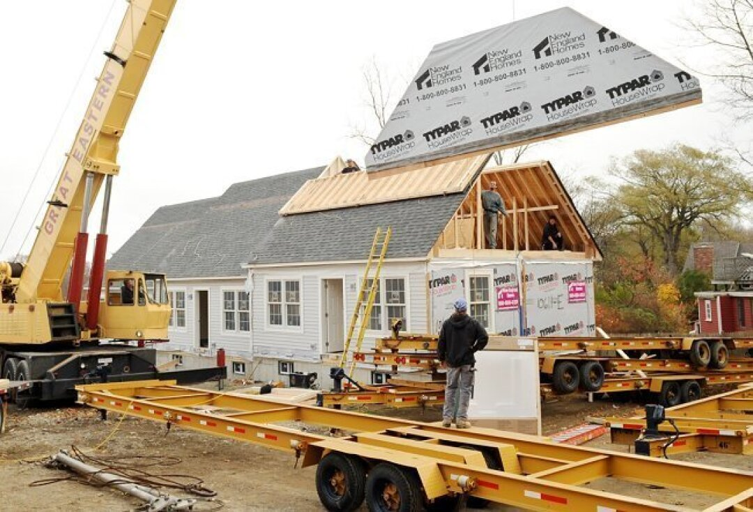 In this photo, a prefabricated home is pieced together in Rockport, Mass.