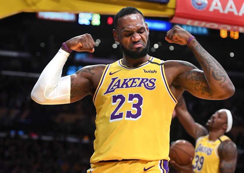 Lakers guard LeBron James celebrates after scoring and drawing a foul against the Knicks during a game Jan. 7, 2020, at Staples Center.