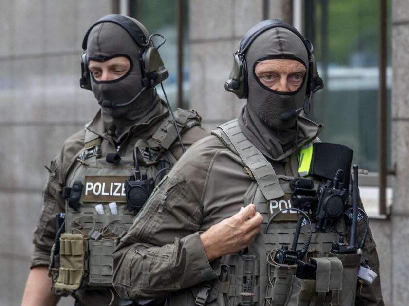 Special Police forces stand in front of the justice building, in Frankfurt, Germany, Tuesday, June 16, 2020. A German court will begin hearing the case against two far-right extremists accused of killing a regional politician. The execution-style slaying of Walter Luebcke shocked the country last year. Stephan E a 46-year-old with previous convictions for violent anti-migrant crimes, will appear in the Frankfurt regional court accused of murder, attempted murder, serious bodily harm and firearms offenses. A second man, identified only as Markus H. due to privacy rules, is charged with accessory to murder and breaking firearms laws. (AP Photo/Michael Probst)
