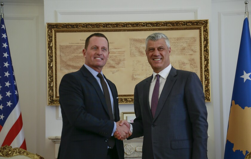 Kosovo's president Hashim Thaci, right, shakes hands with President Donald Trump's envoy for the Kosovo-Serbia dialogue, Ambassador Richard Grenell in Kosovo capital Pristina on Wednesday, Oct. 9, 2019. (AP Photo/Visar Kryeziu)