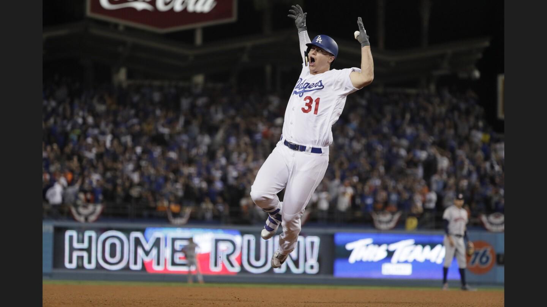 Joc Pederson celebrates a home run in the seventh inning.