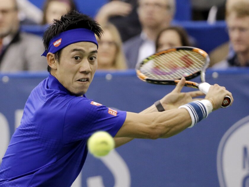 Kei Nishikori, of Japan, returns a shot to Taylor Fritz in the singles championship at the Memphis Open tennis tournament Sunday, Feb. 14, 2016, in Memphis, Tenn. (AP Photo/Mark Humphrey)