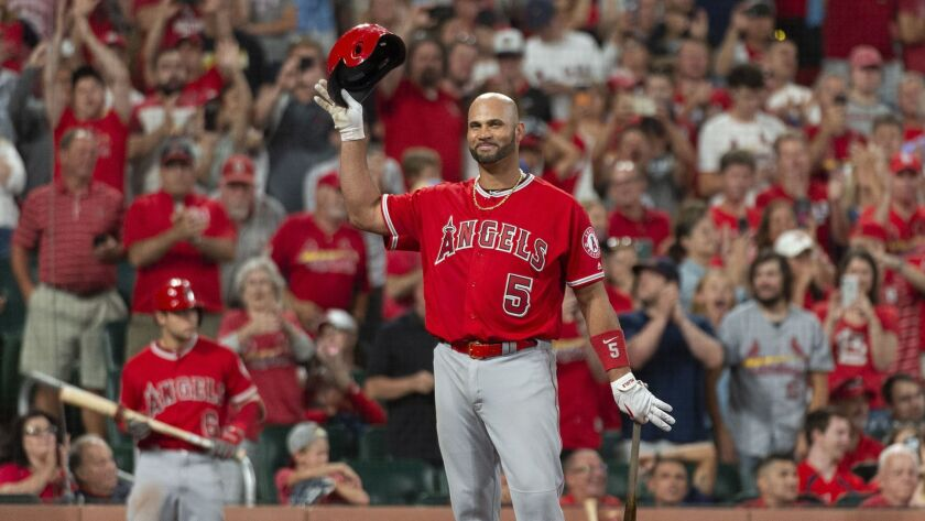 Los Angeles Angels' Albert Pujols tips his cap to the crowd before his final at bat of the night dur