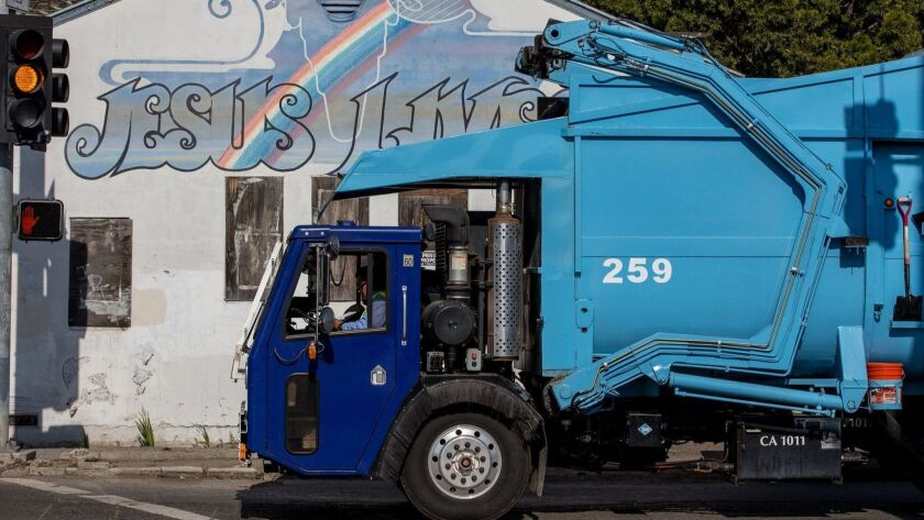 A trash truck from Rainbow Environmental Services on Nichols Lane in Huntington Beach passes the 193
