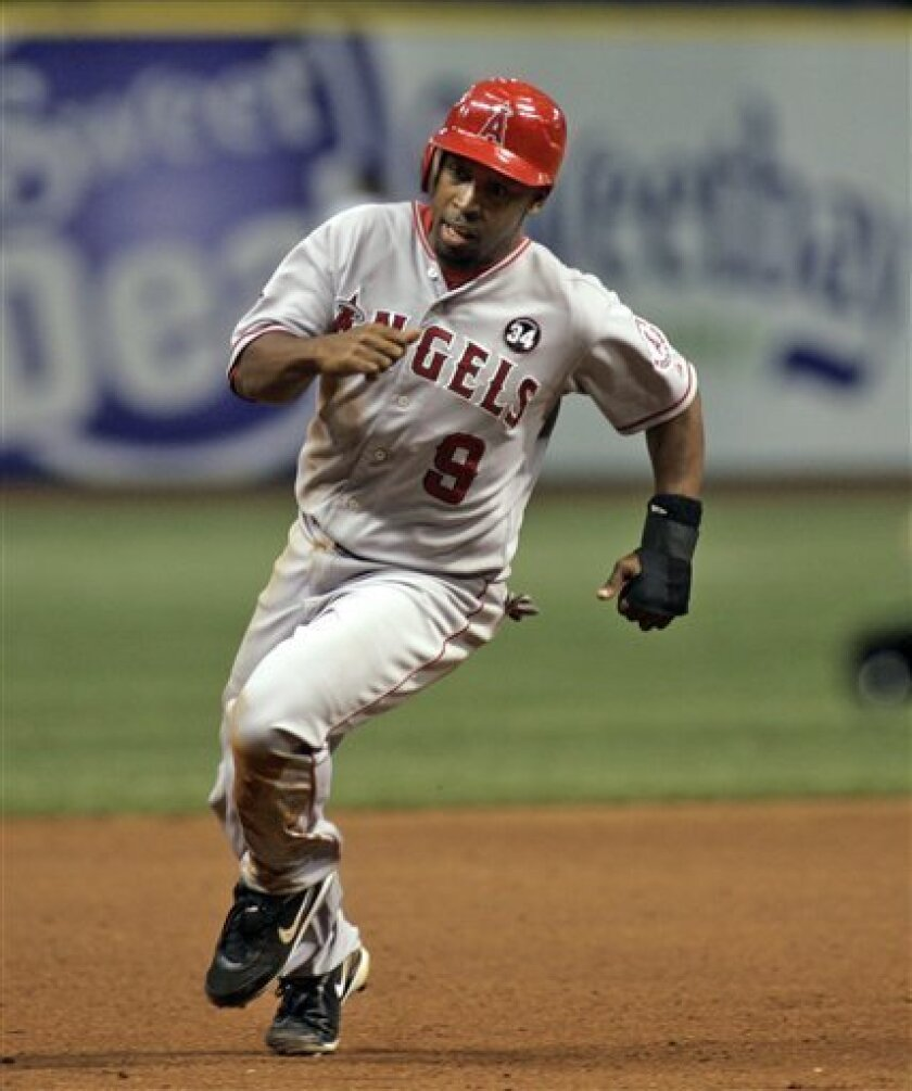 FILE - In this June 9, 2009, file photo, Los Angeles Angels' Chone Figgins (9) rounds third to score on a double by Bobby Abreu during the seventh inning of a baseball game against the Tampa Bay Rays in St. Petersburg, Fla. The Mariners and Figgins have reached a preliminary agreement on a $36 million, four-year contract pending a physical, a person familiar with the deal told The Associated Press on Friday night. (AP Photo/Reinhold Matay, File)