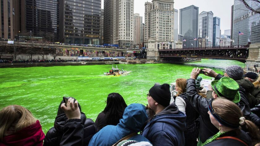 The Plumber's Local Union 130 dyes the Chicago River green to celebrate St. Patrick's Day, Saturday,
