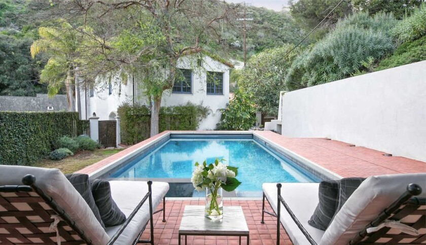 The Mediterranean-style spot includes a courtyard, a tiered patio and a swimming pool.