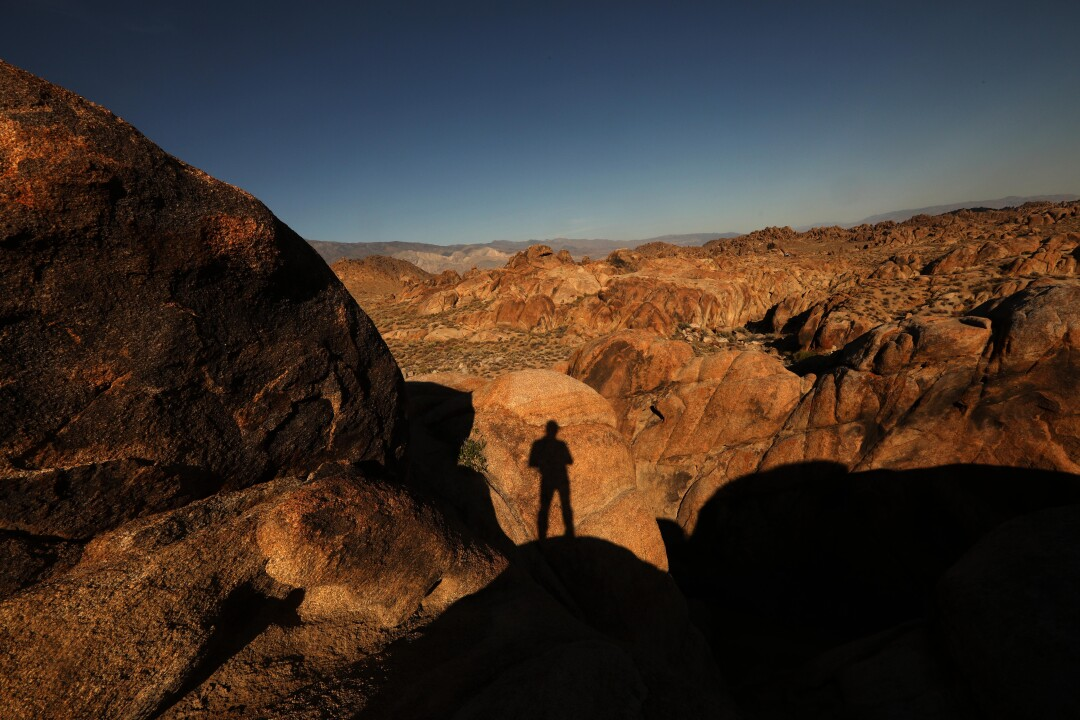 LONE PINE, CA - JUNE 21, 2020 - - A shadow is cast against the Alabama Hills National Scenic Area