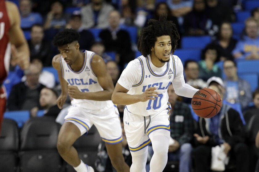 UCLA guard Tyger Campbell controls the ball during a win over Washington State on Thursday.