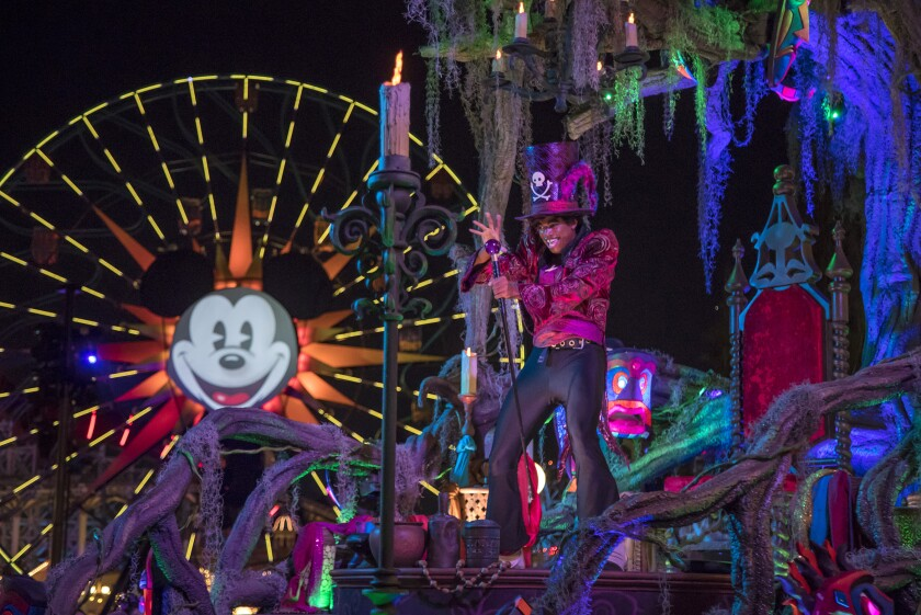 """The """"Frightfully Fun Parade"""" at Disney California Adventure Park is one of the features of the new separate-ticket Oogie Boogie Bash being offered on select nights through Oct. 31. The evil Dr. Facilier from """"The Princess and the Frog"""" (pictured) is one of several Disney villains featured in the parade that winds through the park during the party each evening."""