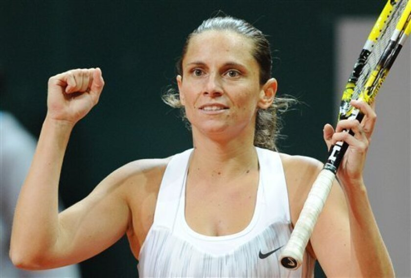 Roberta Vinci of Italy reacts after winning the final match at the WTA Katowice Open tennis tournament against Petra Kvitova of the Czech Republic, in Katowice, Poland, Sunday, April 14, 2013. (AP Photo/Alik Keplicz)