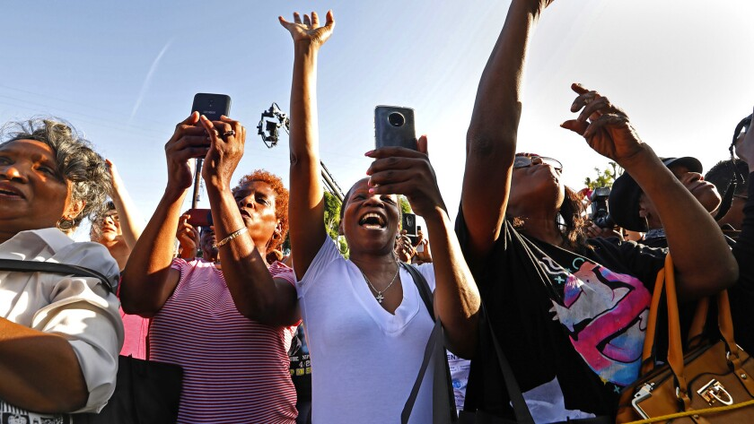 LOS ANGELES, CALIFORNIA--MAY 4, 2019--Crowds cheer as they celebrate the unveiling of Obama Blvd. wh