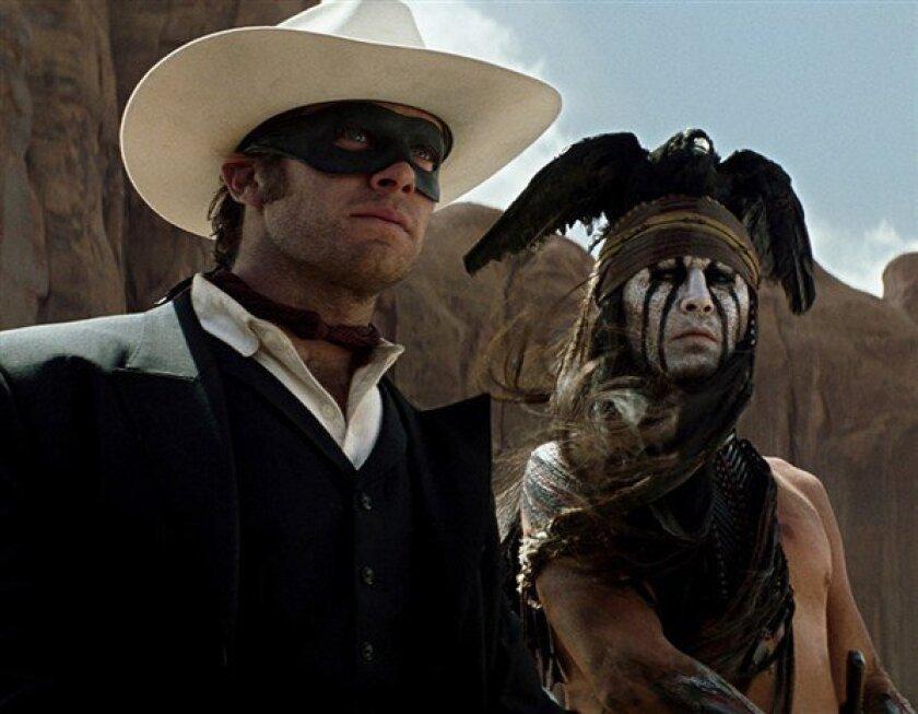 "Armie Hammer, left, stars with Johnny Depp in ""Lone Ranger."""
