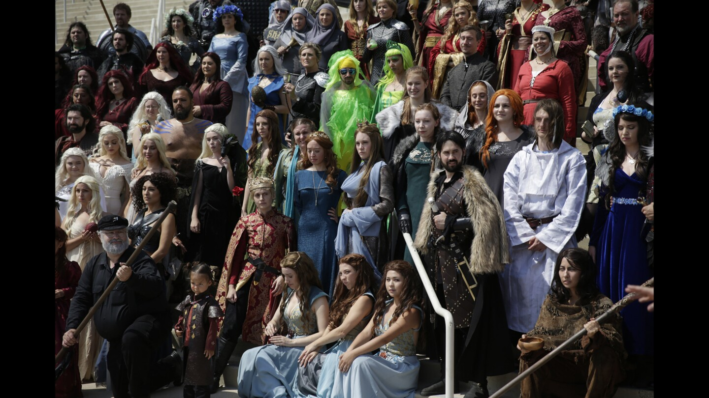 """""""Game of Thrones"""" cosplayers gather for a photo at the San Diego Convention Center during Comic-Con International 2016."""